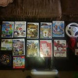 Wii Game System + 12 games + balance board + shotgun in MacDill AFB, FL