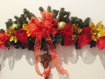 Christmas swag with bow , mesh and flowers in Elizabeth City, North Carolina