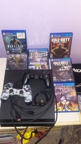 PS4 2 WIRELESS REMOTES WITH CHARGER AND 6 GAMES in Elizabeth City, North Carolina