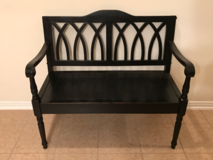 Black distressed bench in Kingwood, Texas