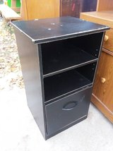 Tall black nightstand in Fort Riley, Kansas