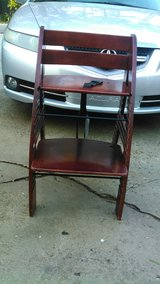 Wooden highchair/booster seat in Perry, Georgia