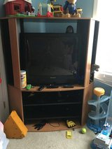 TV WITH REMOTE & TV STAND / ENTERTAINMENT CENTER in Camp Lejeune, North Carolina