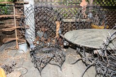 Vintage beautiful black wrought iron new orleans peacock set with marble top in Travis AFB, California