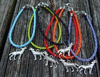 Leather-like wolf bracelets in Bellaire, Texas