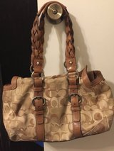 Authentic brown/cream coach in Kingwood, Texas