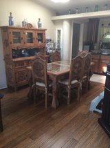 Rustic wood table, chairs and hutch in Cleveland, Texas