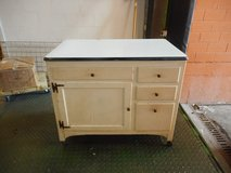 Antique porcelain metal top cream color painted cabinet on wheels in Chicago, Illinois