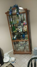 Lighted Display Corner Cabinet With Lots Of Collectible Vintage Glass And Silverware in Kingwood, Texas