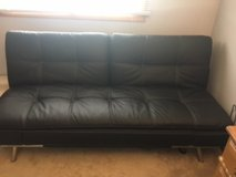 Futon black leather folds from couch to bed in Algonquin, Illinois