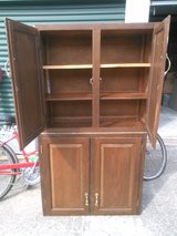(2) Wall wood cabinets with doors (brown stained ).(3) shelves in each one. in Conroe, Texas