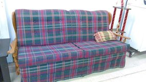 Plaid couch ( older) in Fort Leonard Wood, Missouri