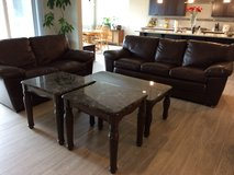 Matching leather sofa and love seat. Also with coffee and end tables in Fort Lewis, Washington