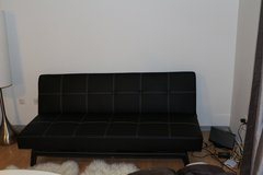 Black leather couch in Stuttgart, GE