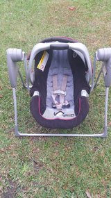 graco click connect 30 car seat  and swing frame in Wilmington, North Carolina
