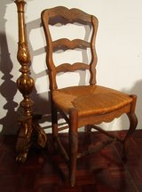 Antique Solid Wood Chair with Wicker Seat in Ramstein, Germany