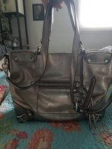 Metallic silver Michael Kors purse in excellent condition. Must pick up in Rolla in Fort Leonard Wood, Missouri