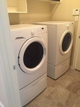 Brand New Front Load Washer and Dryer with Pedestals in Conroe, Texas