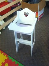 Kids plastic kitchen set and a doll high chair in Conroe, Texas