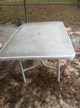 Old solid wood end table and a Patio table with glass top in Spring, Texas