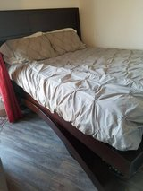 Queen sized wood bed frame, slats and headboard in Buckley AFB, Colorado