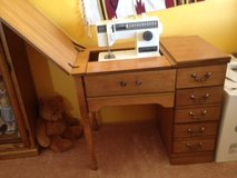 SINGER SEWING MACHINE IN CABINET in 29 Palms, California