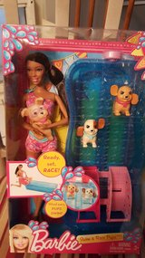 Barbie swim and race pups in Joliet, Illinois