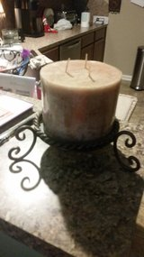 Candle with iron base in Conroe, Texas