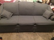 Slate blue queen-sized sofa sleeper with 2 throw pillows in Fort Leonard Wood, Missouri