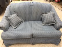 Slate blue love seat with 2 throw pillows in Fort Leonard Wood, Missouri