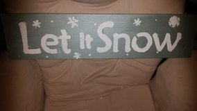 Homemade decor painted and sanded says let it snow in Aurora, Illinois