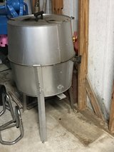 Good size old smokey BBQ pit on legs in Bellaire, Texas