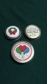 Cross Stitched can tops in Baytown, Texas