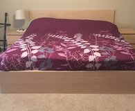 King size bed and nightstands in Fort Carson, Colorado