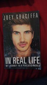 """""""In Real Life"""" softcover, new in Lockport, Illinois"""