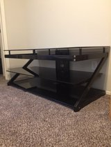 Large tempered glass TV entertaiment stand in Fort Bliss, Texas
