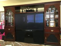 Mitsubishi 65 inch tv and entertainment center in Morris, Illinois