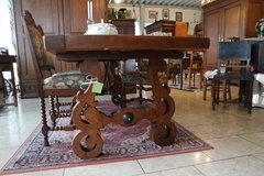 gorgeous solid oak table with wrought iron ornament underneath in Baumholder, GE