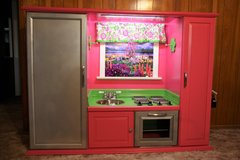 Pink and lime green play kitchen in Pasadena, Texas