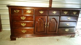 Solid wood dresser cherry color with 9 drawers in Fort Bliss, Texas