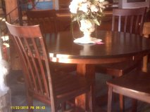 Wood round table and 4 wood chairs in San Diego, California