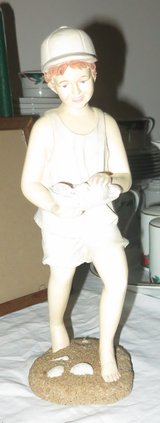 Nice quality statue of boy holding shells in Cherry Point, North Carolina
