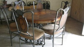 ROUND 48 INCH ROUGHT IRON WITH WOOD TOP TABLE AND 6 CHAIRS in Moody AFB, Georgia