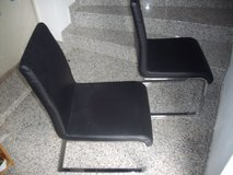 2 black soft leather chairs in Ramstein, Germany