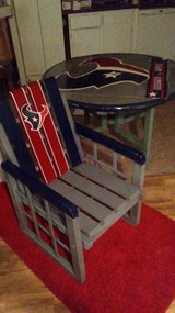 Houston Texans outside table with 4 adirondack chairs and huge red umbrella in Pasadena, Texas