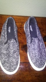 black and white canvas shoes in The Woodlands, Texas
