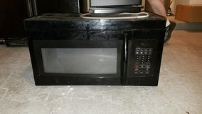 Over the stove microwave in Jacksonville, Florida