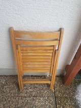4 wooden folding chairs in Ramstein, Germany