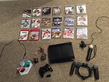 Ps3 Console with 18 games and controller in Batavia, Illinois