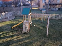 Wooden swing/playset in Fort Riley, Kansas